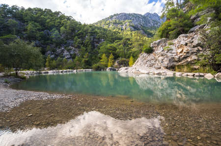 View of turquoise lake in canyon Goynuk, located inside the Beydaglari Coastal National Park, Kemer district in Antalya Province, Turkey