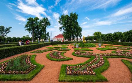 SAINT- PETERSBURG, RUSSIA - JUNE 18, 2018: Monplaisir Palace in the Lower Garden of Peterhof, Saint-Petersburg, Russia. The park ensemble of Peterhof belongs to the world heritage of UNESCO