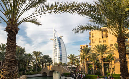 DUBAI, UNITED ARAB EMIRATES - 05 DECEMBER, 2018: Cityscape view from Madinat Jumeirah on famous Seven Star Hotel Burj Al Arab in Dubai, United Arab Emirates