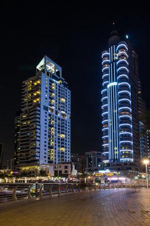 DUBAI, UNITED ARAB EMIRATES - 05 DECEMBER, 2018: Night view on skyscrapers of Dubai Marina, an artificial canal city in Dubai, United Arab Emirates