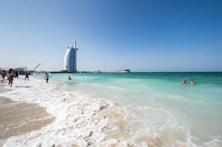 DUBAI, UNITED ARAB EMIRATES - 08 DECEMBER, 2018: View from the beach Jumeira on famous Seven Star Hotel Burj Al Arab in Dubai, United Arab Emirates Editorial