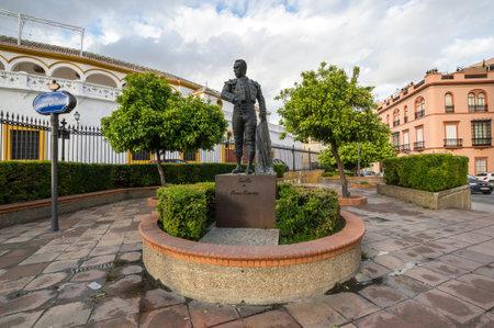 SEVILLE, SPAIN - 08 APRIL, 2019: Statue of a toreador in front of the Plaza de Toros de la Maestranza in Seville, Spain