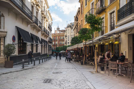 SEVILLE, SPAIN - 08 APRIL, 2019: View of the street in the historical center of Seville, a big tourist center in Spain Editorial