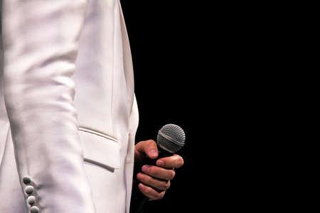 a singer holding a microphone Reklamní fotografie