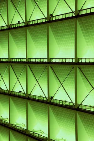 Metal design of an interior in a modern building in green light photo