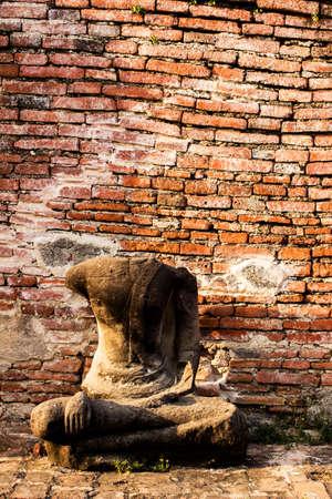 Old buddha statue in Wat Mahathat temple at Ayutthaya, Thailand  photo
