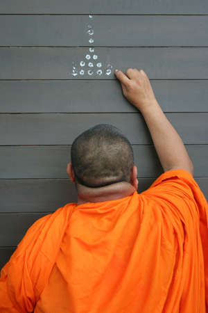 anoint: Thai monk anoints, doing Buddhist ceremony Stock Photo