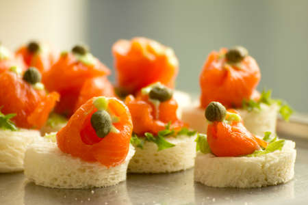 catering service: Salmon canapes at party table Stock Photo