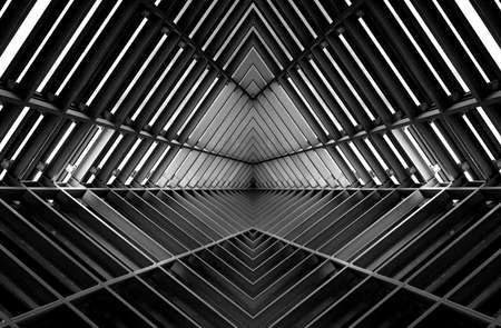 tunnels: metal structure similar to spaceship interior in black and white Stock Photo