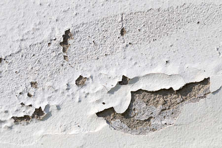 meterial: peeling paint on the white concrete wall Stock Photo