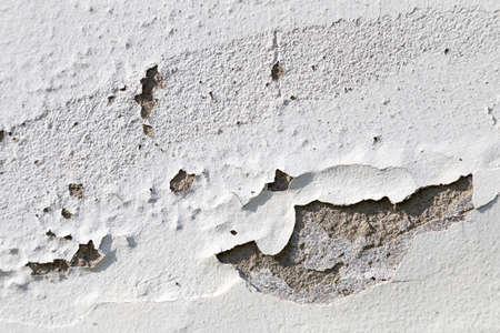 peeling paint: peeling paint on the white concrete wall Stock Photo