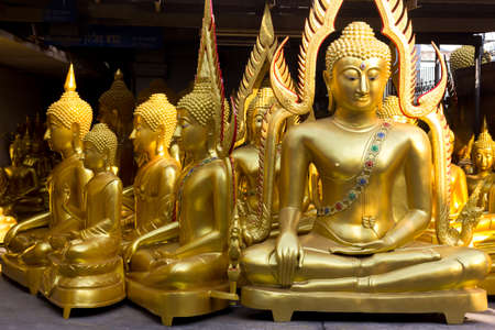 artifacts: Buddha statue in the store, Bangkok, Thailand. Shops specialising in Buddhist artifacts are commonly found near temples throughout Thailand.
