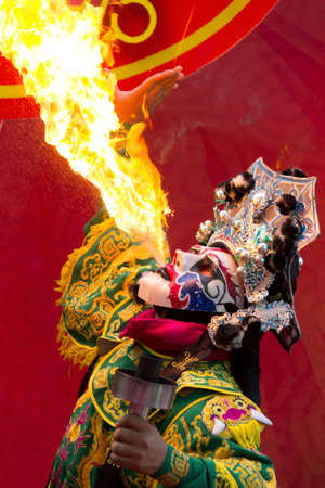 spitting: Chinese New Year, Chinese Opera actor perform spitting fire in the traditional face-changing Stock Photo