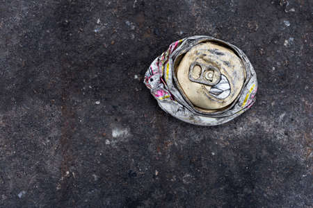 crushed aluminum cans: crushed can on the road Stock Photo