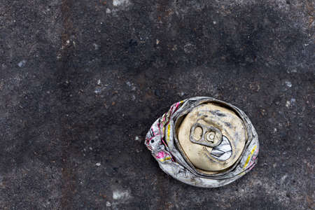 crushed cans: crushed can on the road Stock Photo