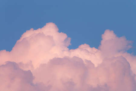 pink clouds in the blue sky