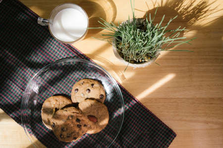 cip: chocolate chip cookie and almond cookie with milk in the morning