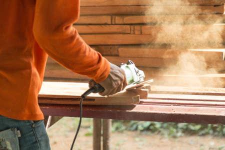 grinder machine: carpenter using grinder machine the old wood