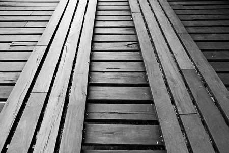 wooden bridge: light reflection on wooden bridge, back and white photo