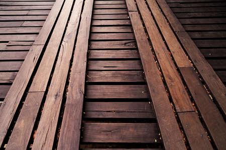 light reflection on wooden bridge