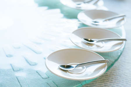 spoon in the white dish on the food table, selective focus Reklamní fotografie