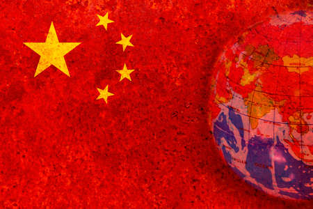 China - January 15, 2015. global in rustic chinese flag, blackground Reklamní fotografie