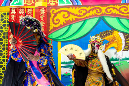Ayutthaya, Thailand - January 8, 2020 : Unidentified Chinese opera actors performs traditional drama and shows mark face-changing on stage in Ayutthaya, Thailand.