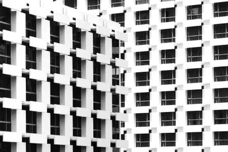 beautiful light and shadow on windows and building balconies of the vintage hotel at the summertime. black and white photo of architecture design. Stock Photo