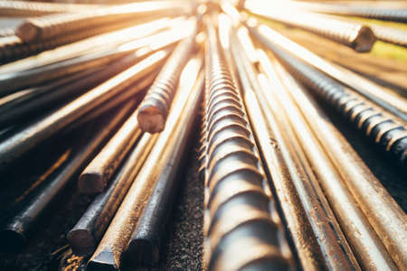 close up steel bar or steel reinforcement bar in the construction site with sunbeam at the morning, steel rods bars can use for reinforce concrete. Stock Photo