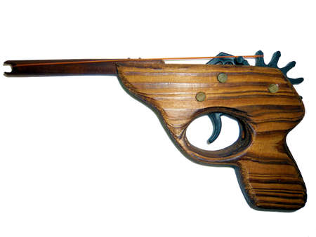 harmless: The harmless gun, wooden handmade rubber-band toy gun Stock Photo