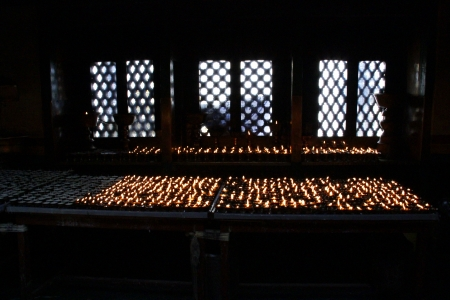 butter lamps in buddhist shrine Swayambunath