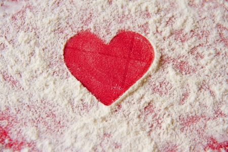 Simple red heart shape cutout in flour