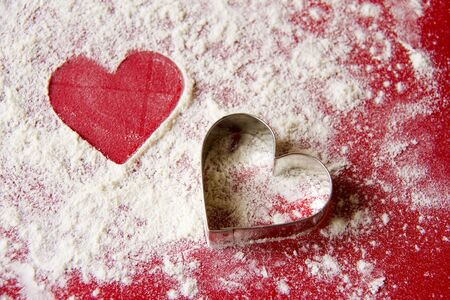 Christmas   Two hearts on red and white background Stock Photo - 16571550