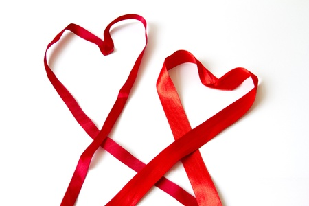 Valentines  two hearts made of red bow on white background Stock Photo - 16829285