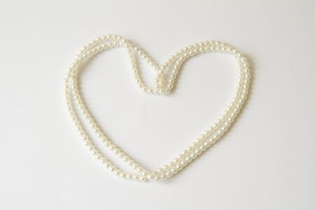 Heart from the pearl necklace Stock Photo