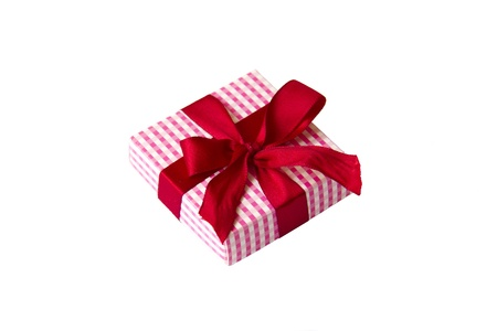 Single small paper giftbox with red bow isolated on white background Stock Photo
