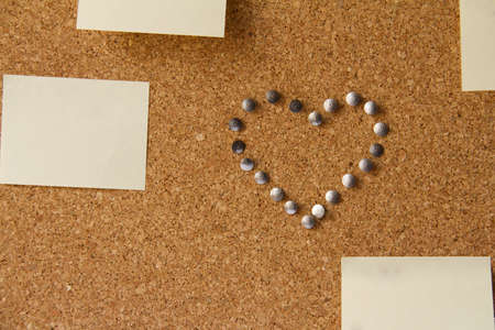 Office board with note papers and heart made from pins Stock Photo - 16902398