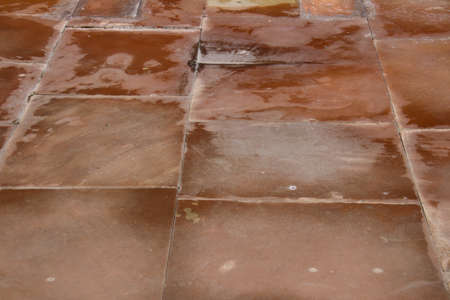 old Red brownn color sandstone pavement surface
