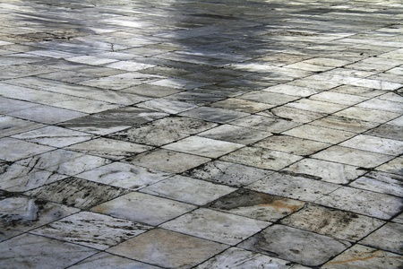 flagging: Flagging, made of square light grey stone tiles, diagonal with perspective