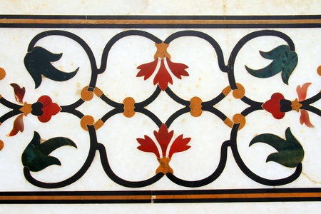 inlaid: Beautiful floral ornament of semi precious stones inlaid in marble