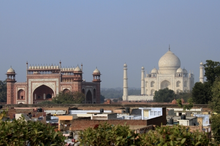 View of world famous monument complex of Taj Mahal and South Gate over the roofs of Agra, India