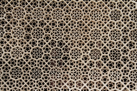 Texture or background of white geometric marble carvings - window in Fatekhpur Sikri