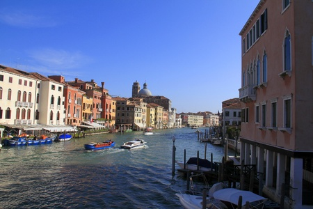 Grand canal with boats and traditional architecture in Venezia, Italy