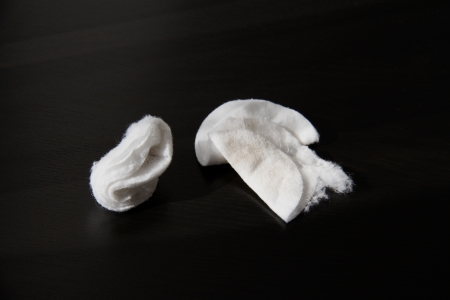 make dirty: Cotton pads after removing make-up on the table