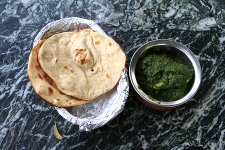 indian meal: Indian meal: indian flat bread naan with meat in spinach souce