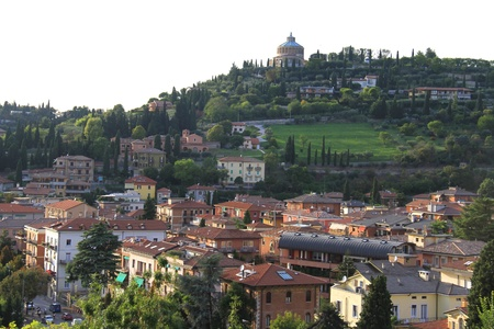 View of northern italian city Verona suburbs with castel san pietro hill  in the background