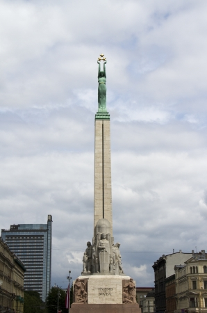 Famous sight in Riga - statue of Mother Latvia, holding three stars - Latvian freedom monument