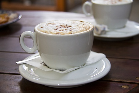 Italian hot coffee  drink - cappuccino served in cup in caf�