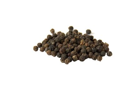 Spices Dried black pepper fruits isolated on white background