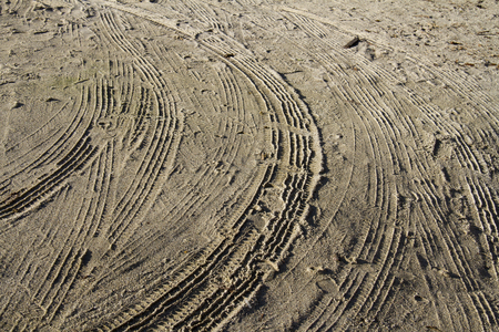 Texture of sandy road with carwheel print pattern